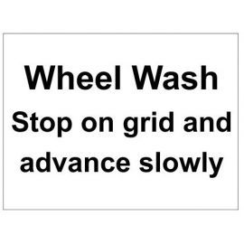 Wheel wash stop on grid and advance slowly parking sign in a variety of sizes and materials